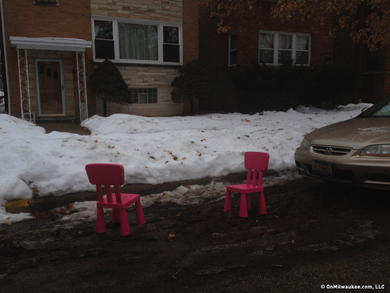 "In Chicago, people mark their spots with a variety of objects, calling ""dibs"" on it, like with these colorful chairs."