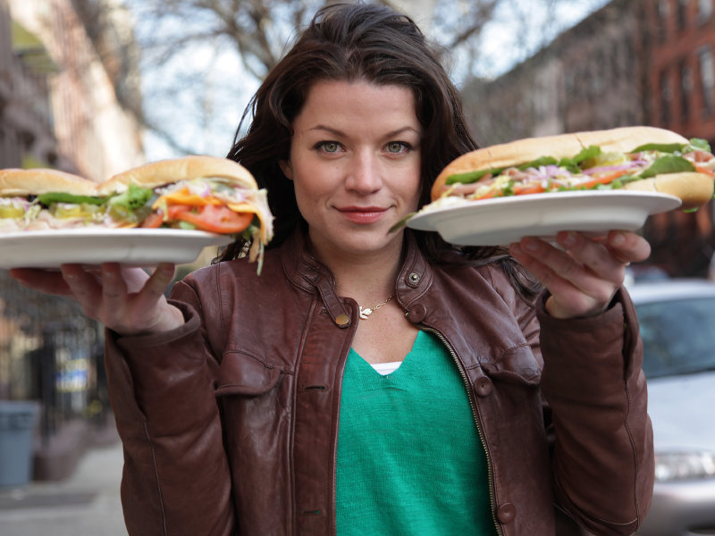 "Camille Ford will be holding burgers when she comes to town for Travel Channel's ""Food Wars."""