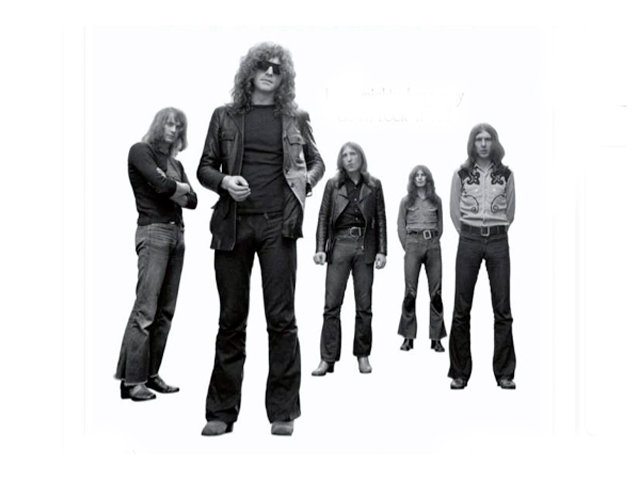 Mott the Hoople, with Ian Hunter with his instantly recognizable shades and locks.