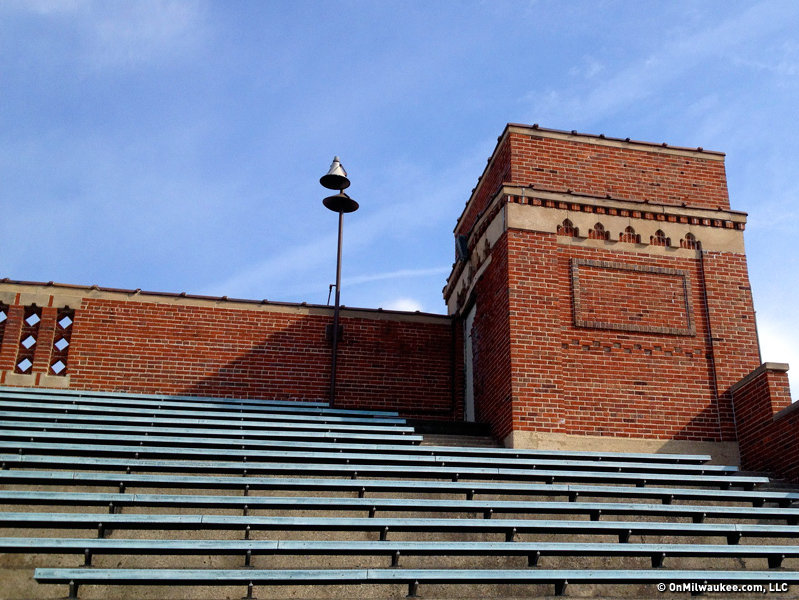 The stadium has two sets of stepped brick bleachers. The north bleachers are adorned with a pair of towers.