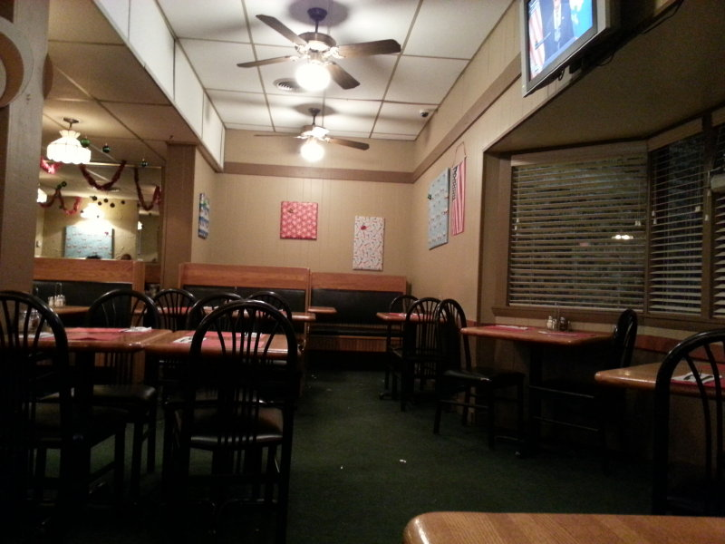 The dining room is cozy, featuring a combination of booths and tables.