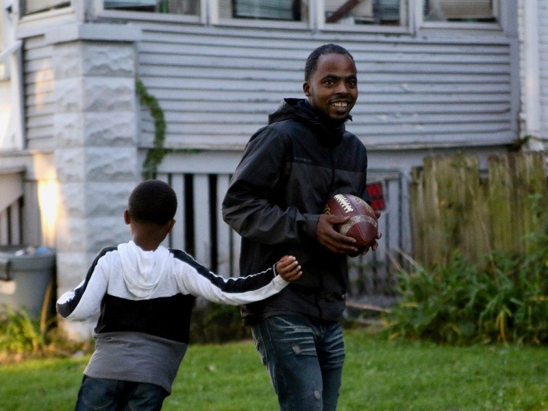 Youth coach uses football to teach players life lessons on