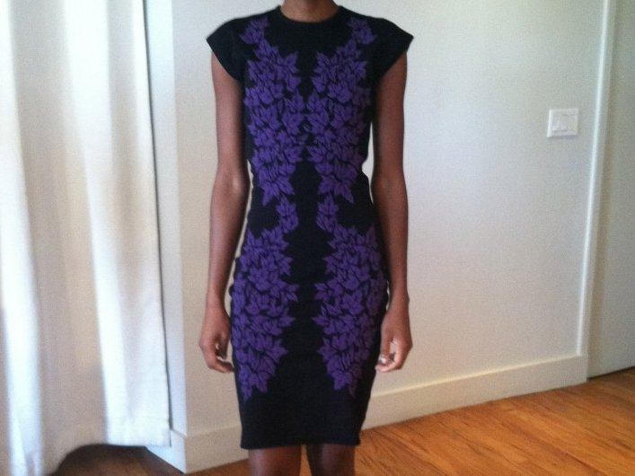 This McQ knit dress with mirror detail is now offered in Mequon. This mirroring technique is very signature of McQueen.