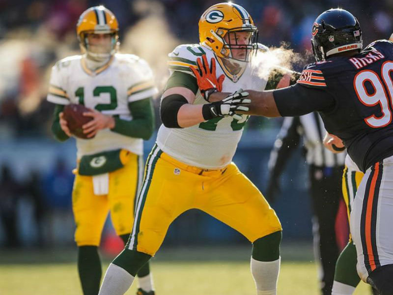 Quarterback Aaron Rodgers (left) and right guard T.J. Lang were two of the Packers  named to the Pro Bowl. bacee6d60
