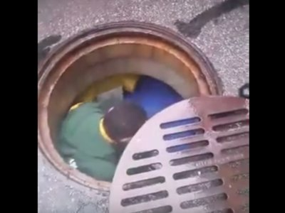 Fan jumps into sewer Image