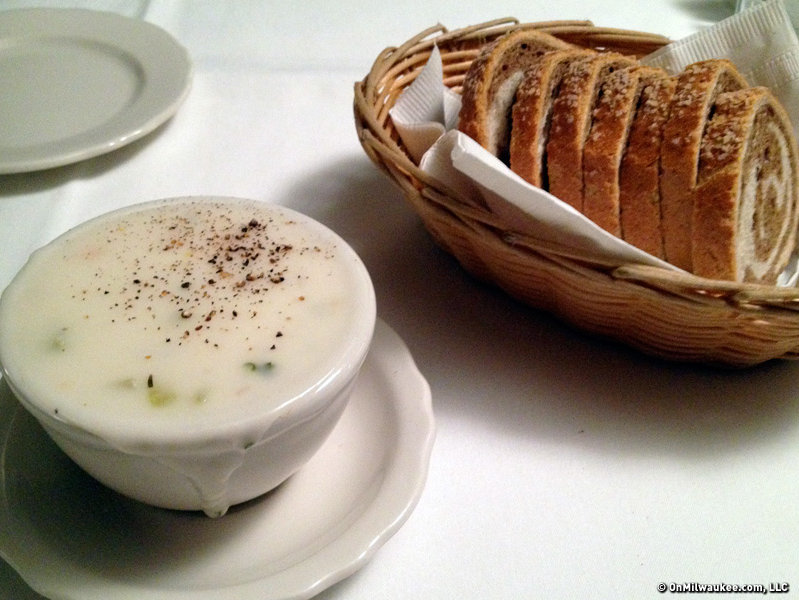 Even at lunch it comes with a hearty helping of New England clam chowder and marble rye.