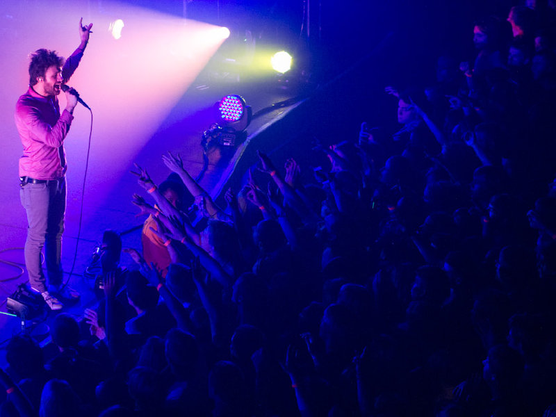 Lead singer Michael Angelakos performs with Passion Pit Thursday night at the Riverside Theater.