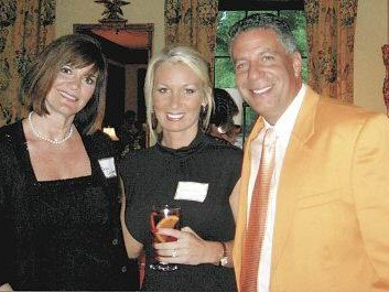 Bruce Pearl and Brandy Miller (middle) got engaged last week.