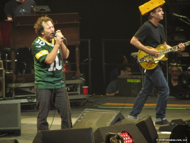 Eddie Vedder, left, and Stone Gossard play to the crowd, literally, in Packers gear.