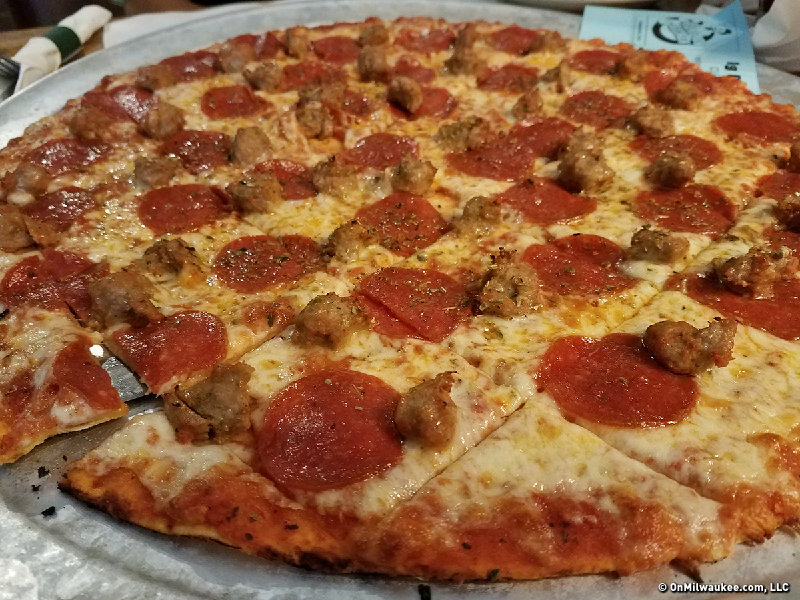 perfect pizzeria This perfect margherita pizza recipe yields a chewy crust with a nice tang—the quintessential base for a bright tomato sauce and fresh buffalo.