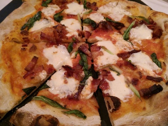 The bacon and ramps pizza from Mangia Wine Bar.