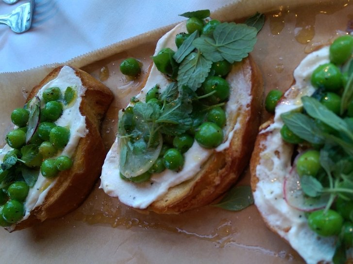 An appetizer of spring pea bruschetta.
