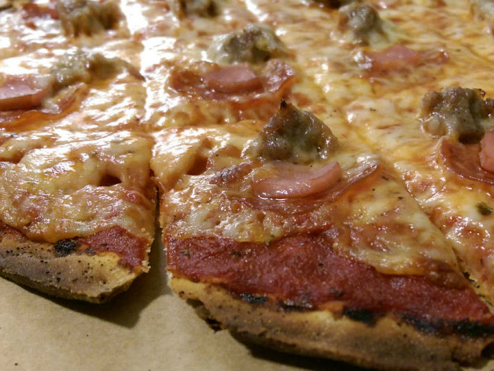 A pepperoni, sausage and Canadian bacon pizza - also known as The Dino - from Bari Pizzeria.