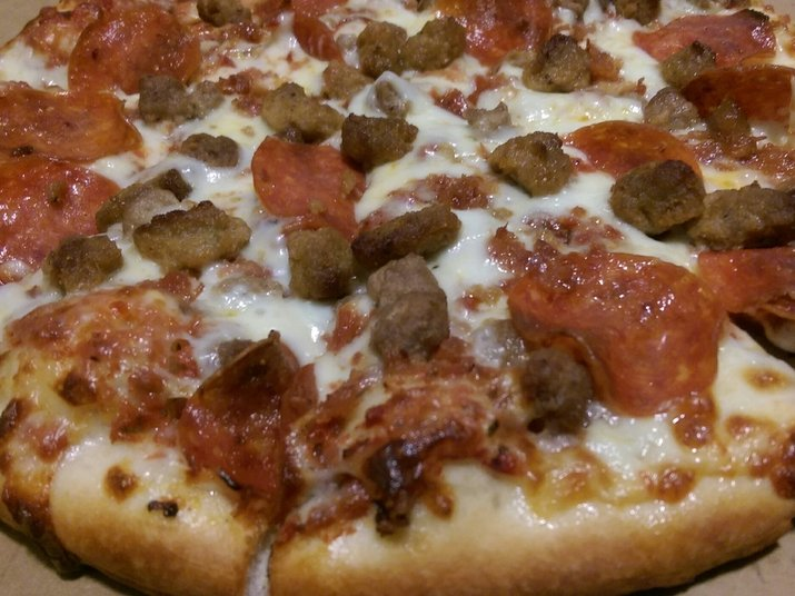 National Pizza's Meat Madness pizza on its original hand-tossed thin crust.