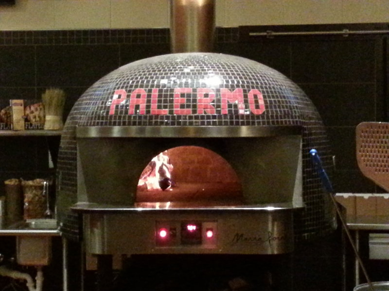 The wood-fired oven at Pizzeria 3301 at Villa Palermo.