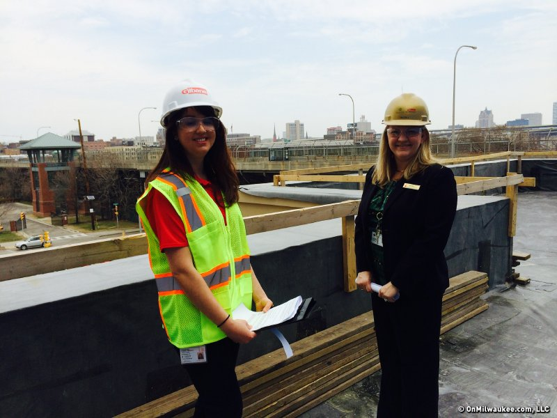 Internal communications specialist Chantel Kuczmarski  (on left) and Kaelyn Cervero on the hotel patio.