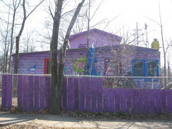 The purple house was torn down in 2010.