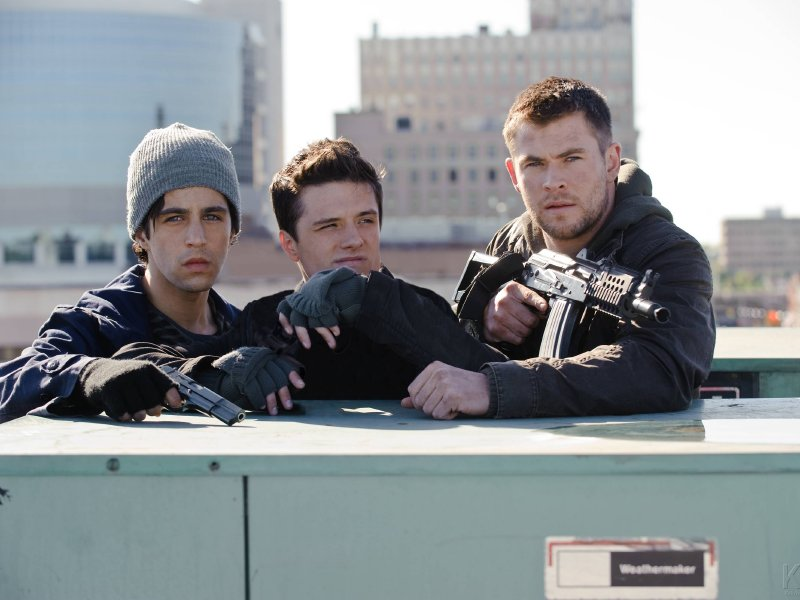 "Josh Peck, Josh Hutcherson and Chris Hemsworth in the new ""Red Dawn,"" in theaters now."