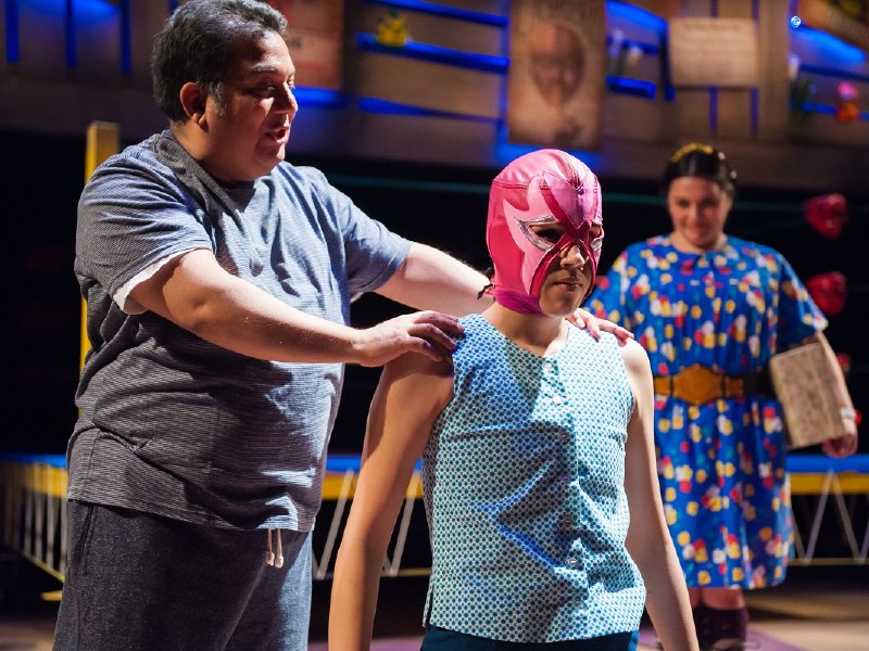 David Flores puts the Mascara Rosa on his daughter, played by Bree Kazinski.