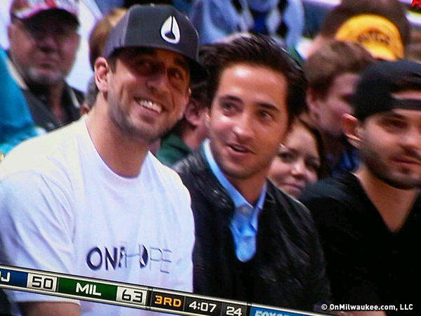 Rodgers and Braun court side at Bucks/Nets in Milwaukee.