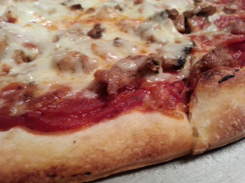Sausage, pepperoni and fresh mushrooms on thin crust.