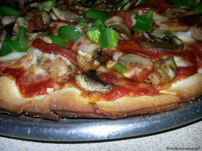 Sofia's sausage, pepperoni, mushrooms and green peppers on thin crust.