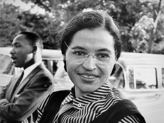 Rosa Parks, shown here with Martin Luther King, Jr. in 1955, turns 100.