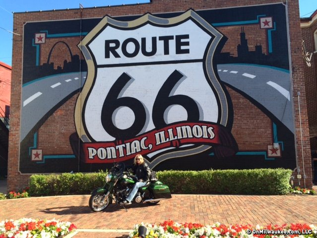 Tami Greene, development manager for the Harley-Davidson Museum, poses for a photo in front of the Route 66 mural painted on the side of the building in Pontiac