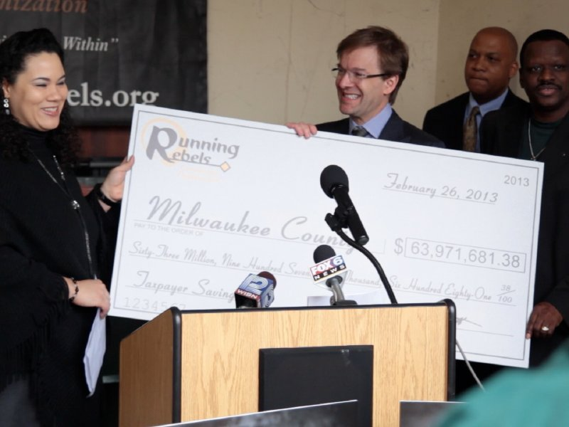 Running Rebels presented the county a check, symbolizing the almost $64 million it's saved.