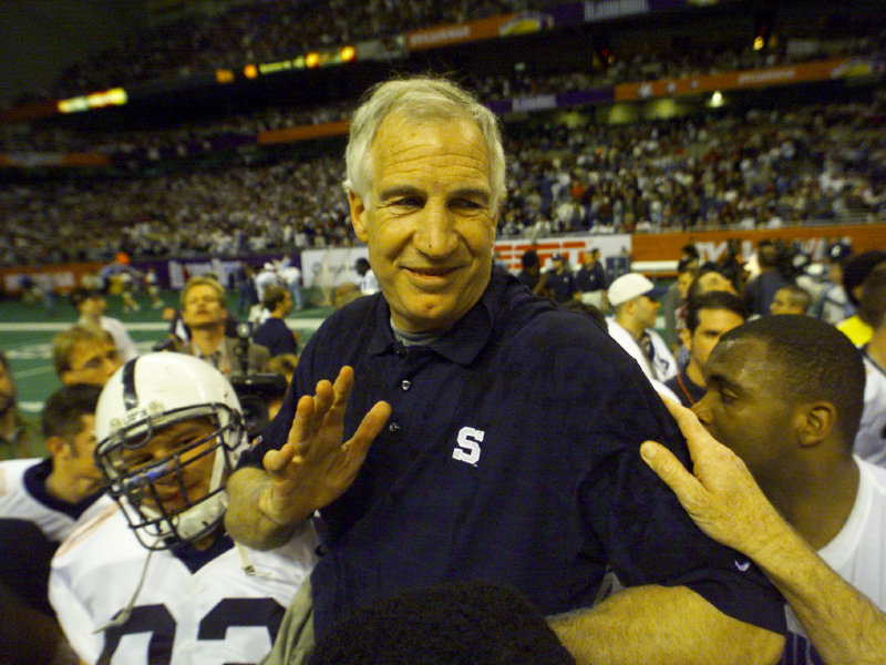 After his final game as Penn State's defensive coordinator in 1999, Jerry Sandusky is carried off the field at the Alamo Dome in San Antonio.