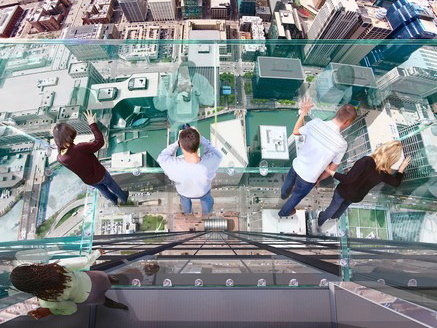 The glass observation boxes are located on the top floor of the Sears Tower. They opened to the public less than a week ago.