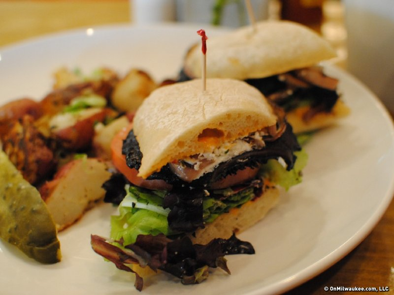 The portobello mushroom sandwich is served with lightly fried red potatoes.