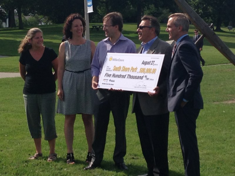 Park and county representatives accept a check for $500,000 from MillerCoors, dedicated to fixing South Shore Beach.