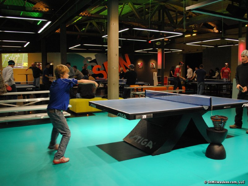 Superbe Some Kids Already Play A Competitive Game Of Ping Pong.