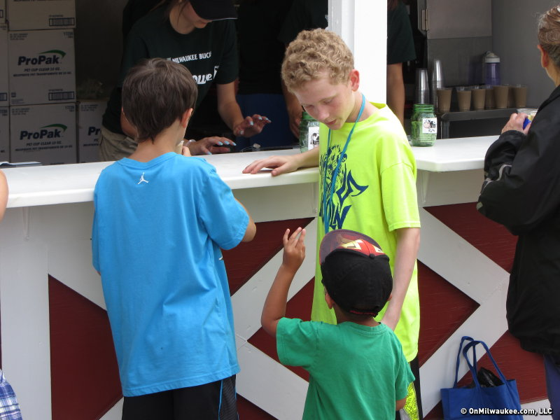 The 25 cent cost of a cup of milk attracts even the youngest of fair goers.