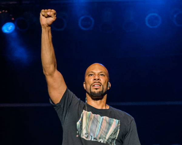 Image result for rapper common with his raised fist
