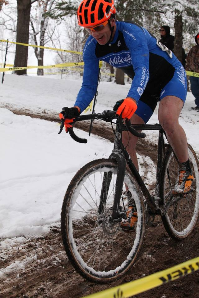 MBC Cyclocross Racing Team member riding through rutted mud and snow.