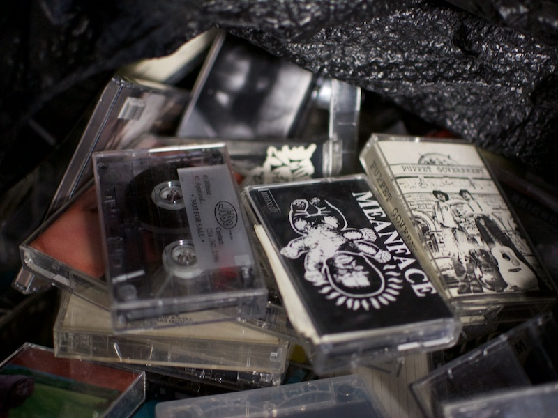 A garbage bag full of demo tapes, including Meanface, Puppet Government and Jibe.