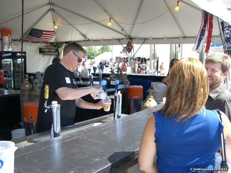 Senior Editor Drew Olson serves beer at Summerfest.  sc 1 st  OnMilwaukee & Shift switch: Summerfest bartender for a day - OnMilwaukee