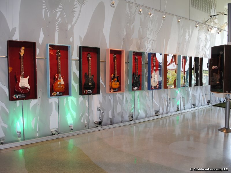 The 45th anniversary Summerfest tribute exhibit features 23 signed guitars.