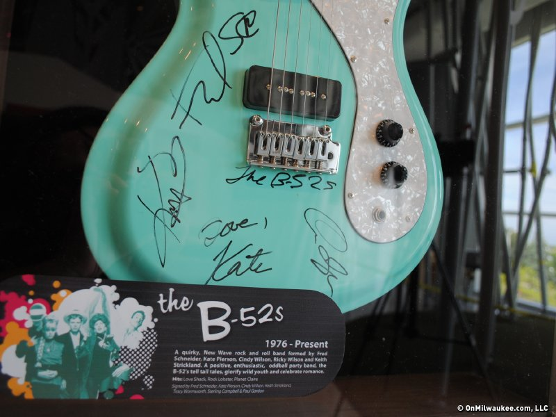 The B-52s signed a guitar as a thank you.