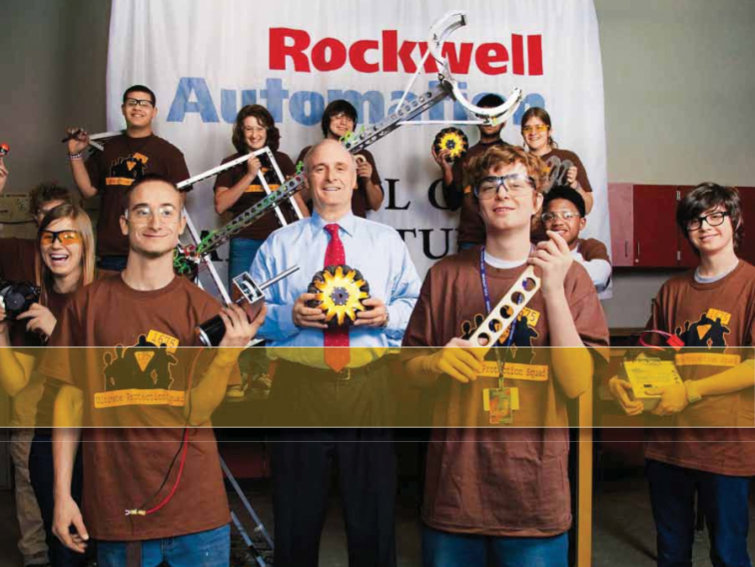 Rockwell CEO Keith Nosbusch with a group of MPS students at Bradley Tech.