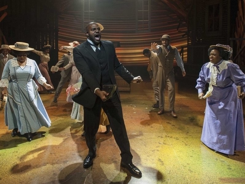 "Carl Clemons Hopkins (center) belts out a number in ""The Color Purple."""