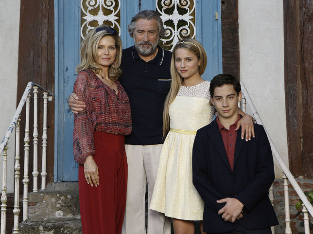 "Michelle Pfeiffer, Robert De Niro, Dianna Agron and John D'Leo are ""The Family,"" now playing."