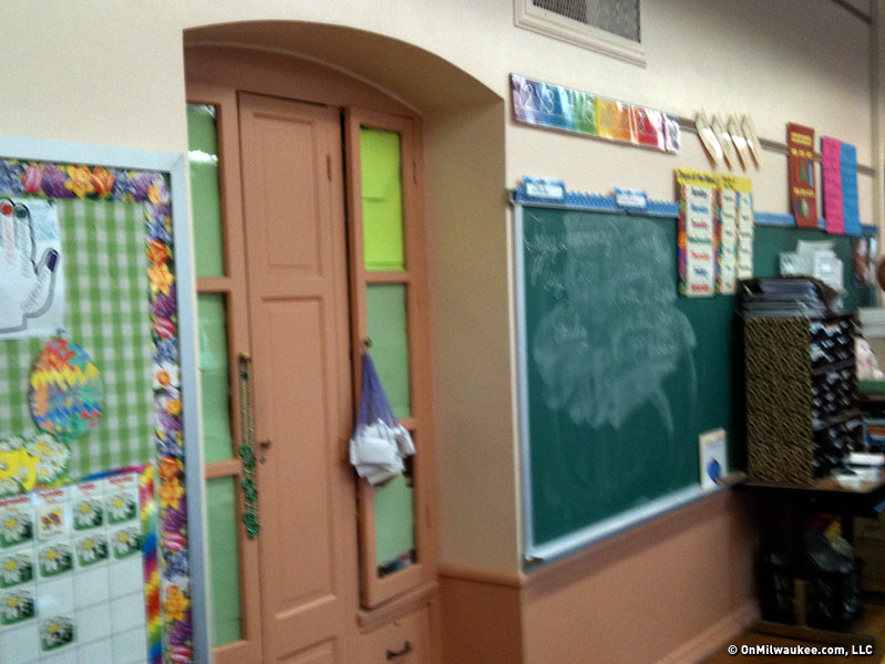 "You can see the ""Pepto Bismol pink"" paint principal Tom Matthews described on this classroom cupboard."