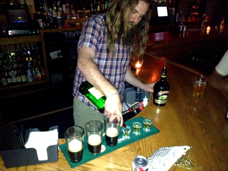Petey the bartender, pouring shots.