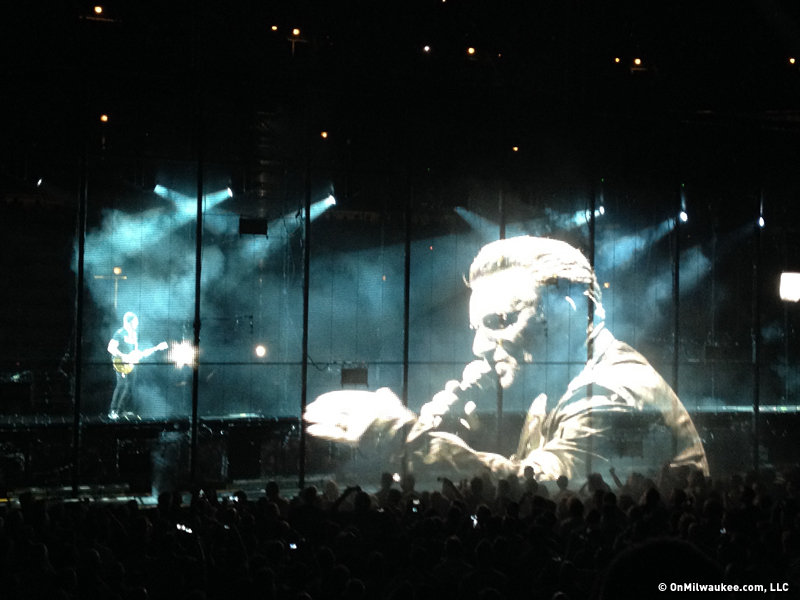 Bono, larger than life, and The Edge.