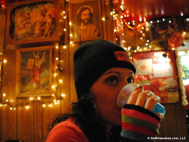 Drinking a blue soda at Maria's, 2010.