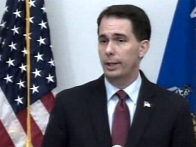 Walker drops out of race
