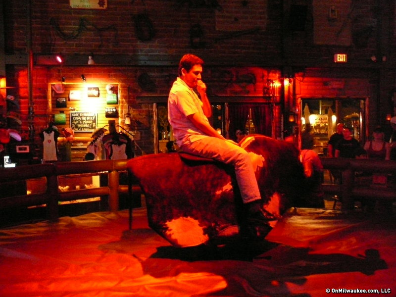 Oscar gets ready to ride a mechanical bull ...